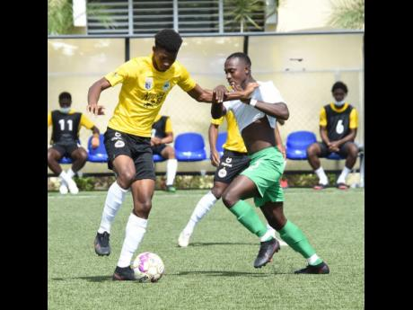 Ian Allen Richard King (left) of Cavalier getting the better of  Vere United's Orane Ferguson during their Jamaica Premier League match last Saturday. Cavalier won 1-0.